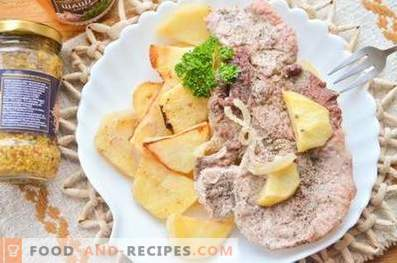 Свинско месо на компир перница во рерна